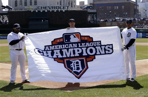 Detroit Tigers first baseman Prince Fielder, left, pitcher Justin Verlander, center, and third baseman Miguel Cabrera unveil a 2012 American League Championship banner before their opening day baseball game against the New York Yankees, Friday April 5, 2013, in Detroit. (AP Photo/Paul Sancya)