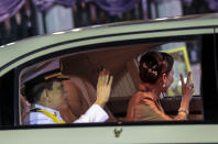 Thailand's King Maha Vajiralongkorn, left and Queen Suthida wave from a limousine after officiating a graduation ceremony at Thammasat University in Bangkok, Thailand, Saturday, Oct. 31, 2020. Thailand's king has presided over a university graduation ceremony at a stronghold of a protest movement seeking to reduce the monarchy's powers, after activists issued a call for students to boycott the event. (AP Photo/Sunti Teapia)
