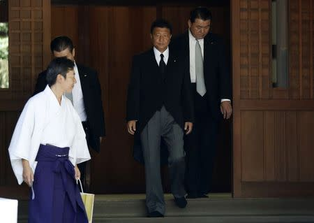Japan's Internal Affairs and Communications Minister Yoshitaka Shindo leaves after visiting the Yasukuni Shrine in Tokyo August 15, 2014, to mark the 69th anniversary of Japan's surrender in World War Two. REUTERS/Yuya Shino