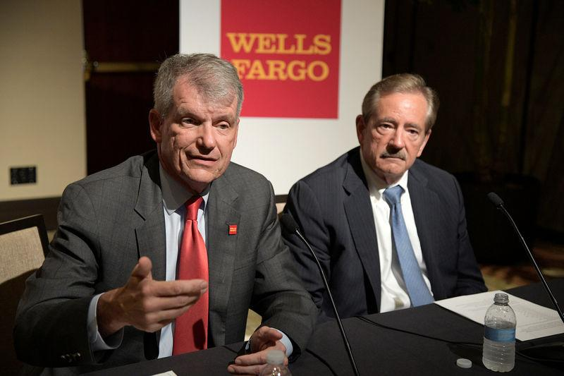 Wells Fargo CEO Tim Sloan (L) and Chairman Stephen Sanger answer questions from reporters after the annual shareholder meeting in Jacksonville