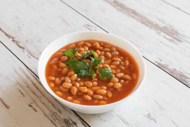 Beans in tomato sauce in a white porcelain bowl