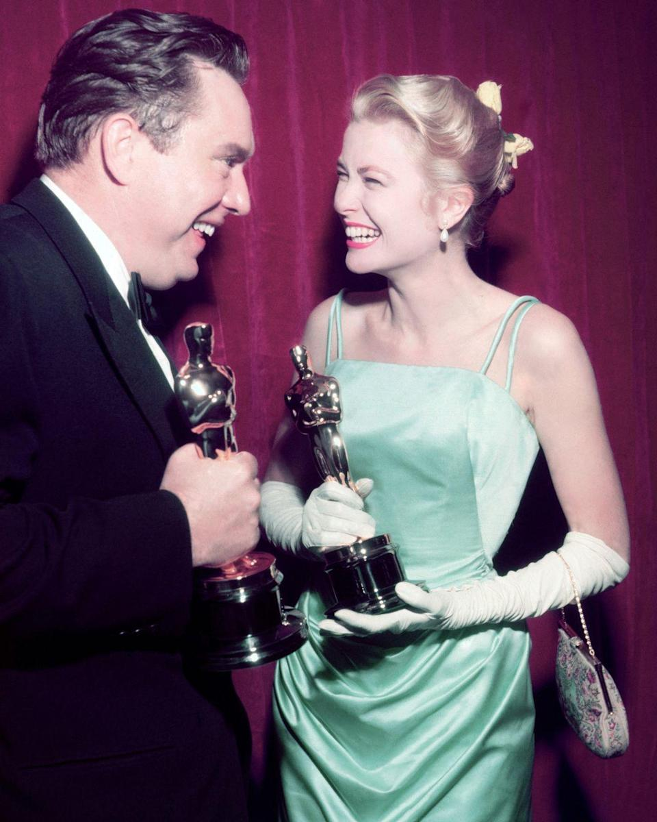 <p>Before she became the Princess of Monaco in 1956, she won the Oscar in '55 for her role in <em>The Country Girl</em>. She wore a stylish sea-foam green gown with spaghetti straps and it featured a flowing train. </p>