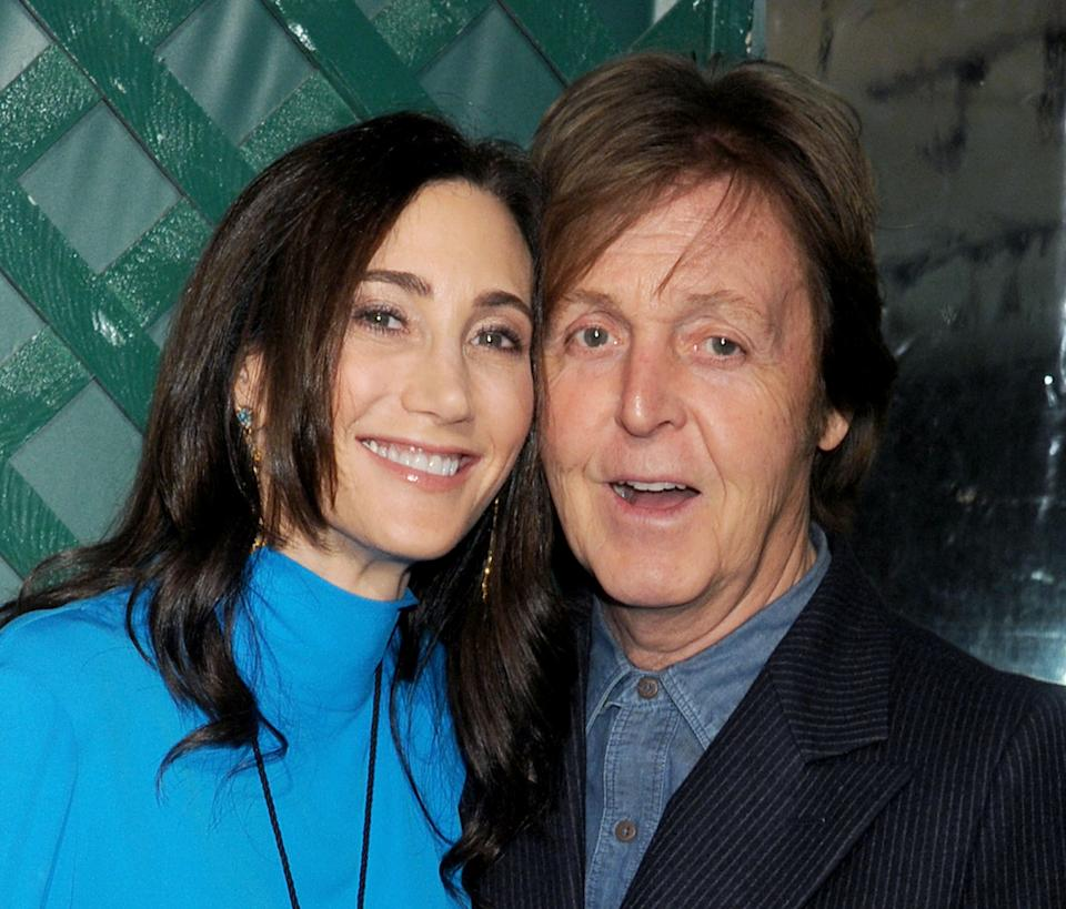 WEST HOLLYWOOD, CA - APRIL 13:  Musician Paul McCartney (R) and wife Nancy Shevell arrive at the world premiere of