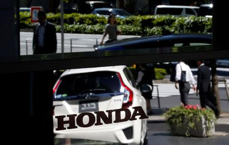 Honda posts loss as it seeks to draw a line under takata for Honda finance corp