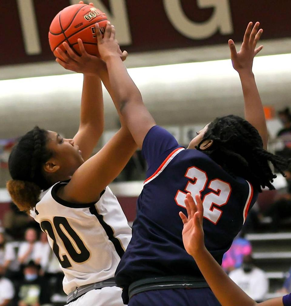 Mansfield guard Kendyl Howell (20) tries to get a shot off against Sachse guard Micah Cooper (32) during the first half of the 6A Region II Girls Basketball Area -Round 2 played February 23, 2021 at Lewisville High School. (Steve Nurenberg Special to the Star-Telegram)
