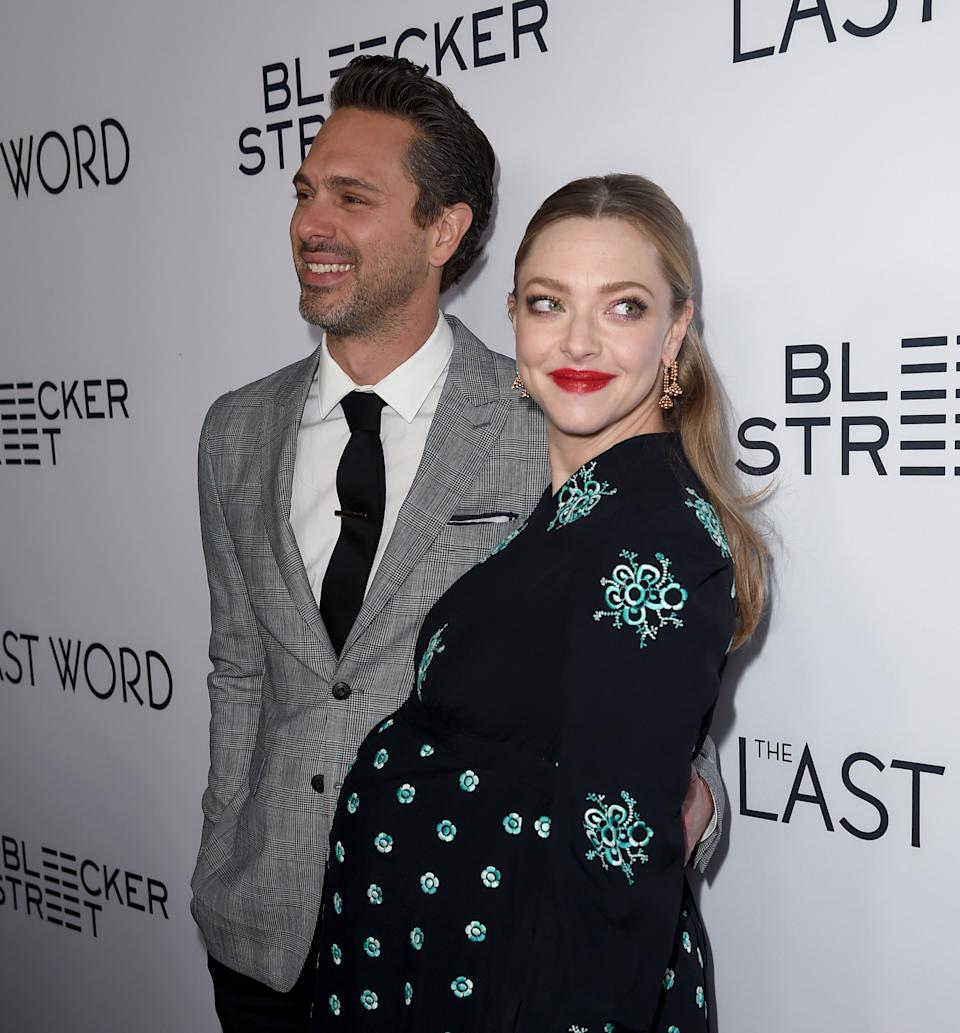 """HOLLYWOOD, CA - MARCH 01:  Actors Thomas Sadoski (L) and Amanda Seyfried at the premiere of Bleecker Street Media's """"The Last Word"""" at ArcLight Hollywood on March 1, 2017 in Hollywood, California.  (Photo by Kevin Winter/Getty Images)"""
