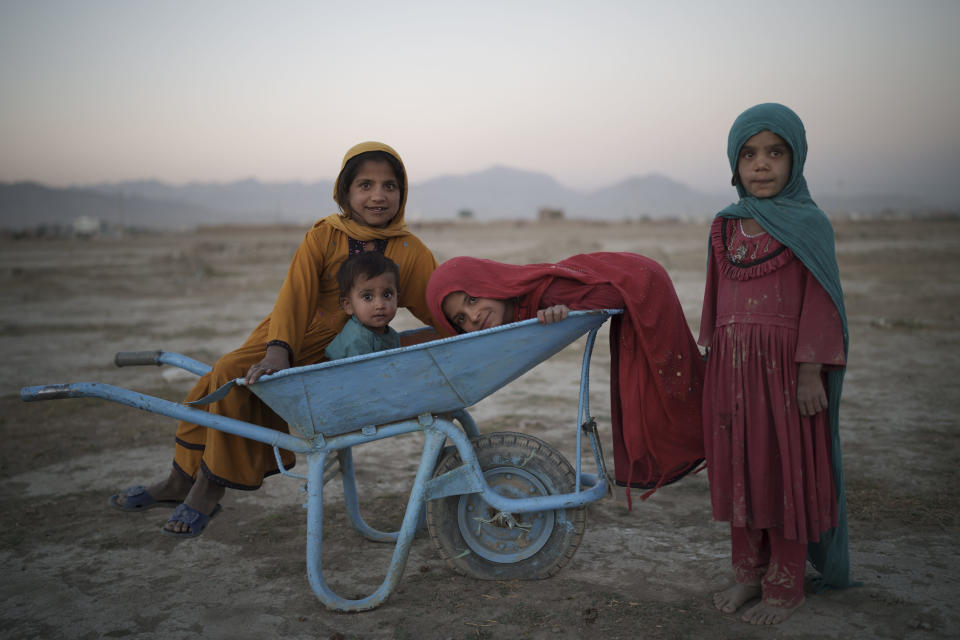 Children pose for a photo as they play in a camp for internally displaced people in Kabul, Afghanistan, Monday, Sept. 13, 2021. (AP Photo/Felipe Dana)