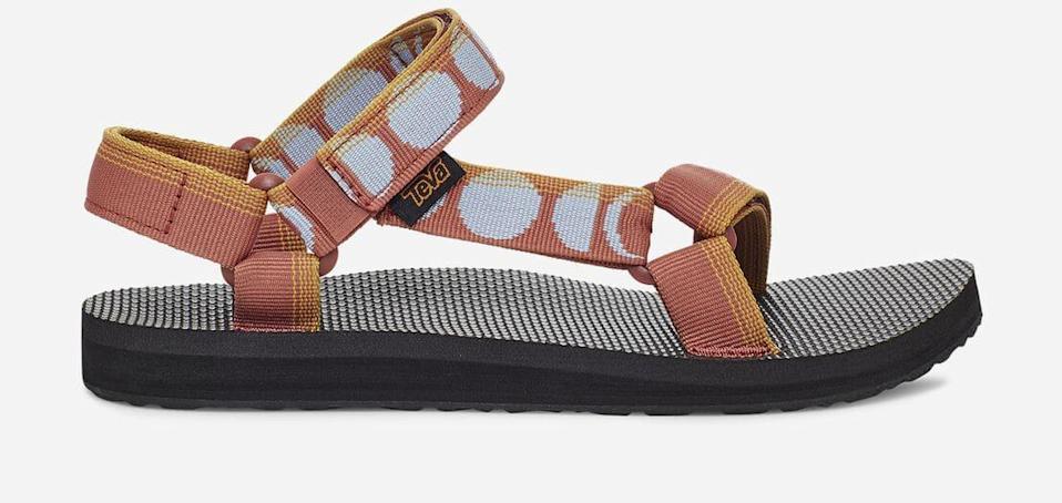 """<h2>Teva Sandals</h2><br>""""They're comfortable and practical, and don't look awful. Great for the beach, but also good for the bodega run. I don't know if that makes them perfect for a gay outfit, but I guess practicality is pretty gay."""" – <em>Heather McTavish, Copy Creative Director</em><br><br><em>Shop <strong><a href=""""https://www.teva.com"""" rel=""""nofollow noopener"""" target=""""_blank"""" data-ylk=""""slk:Teva"""" class=""""link rapid-noclick-resp"""">Teva</a></strong></em><br><br><strong>Teva</strong> Original Universal, $, available at <a href=""""https://go.skimresources.com/?id=30283X879131&url=https%3A%2F%2Fwww.teva.com%2Fwomen-sandals%2Foriginal-universal%2F1003987.html"""" rel=""""nofollow noopener"""" target=""""_blank"""" data-ylk=""""slk:Teva"""" class=""""link rapid-noclick-resp"""">Teva</a>"""