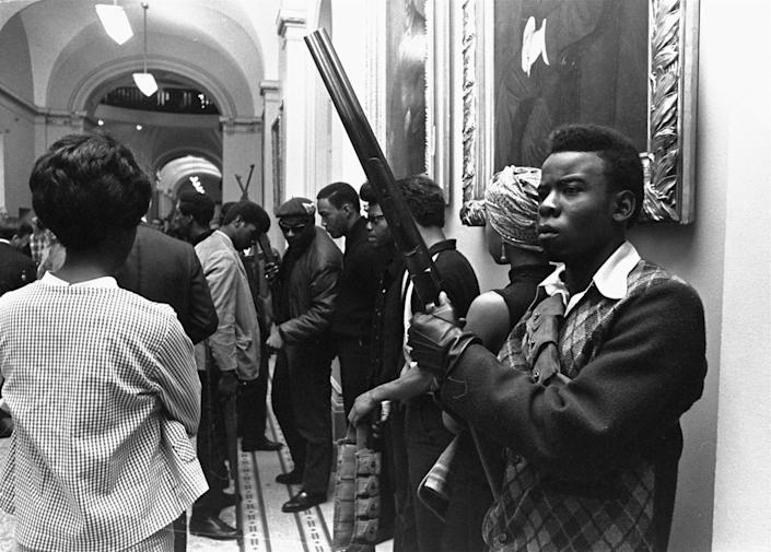 Armed members of the Black Panthers Party stand in the corridor of the Capitol in Sacramento, California, on May 2, 1967. They were protesting a bill before an Assembly committee restricting the carrying of arms in public.