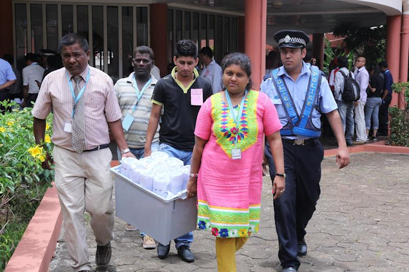 Ballot boxes are transfered from the north of the island of Mauritius to be counted on December 11, 2014 after parliamentary polls (AFP Photo/Nicholas Larche)