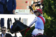 John Velazquez riding Medina Spirit throws a rose after his victory in the 147th running of the Kentucky Derby at Churchill Downs, Saturday, May 1, 2021, in Louisville, Ky. (AP Photo/Jeff Roberson)