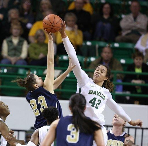 Baylor's Brittney Griner, right, blocks the shot of Oral Roberts Bernadett Balla, left, in the first half of an NCAA women's basketball game on Wednesday, Dec. 12, 2012, in Waco, Texas. (AP Photo/Rod Aydelotte, Waco Tribune Herald)