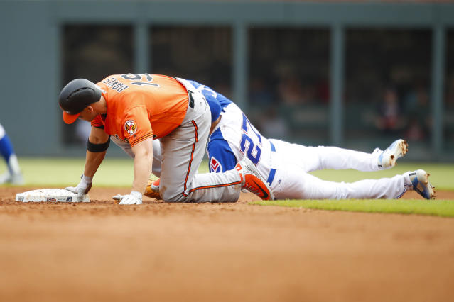 Baltimore Orioles Chris Davis (19) slides into second base avoiding the tag of Atlanta Braves third baseman Ryan Flaherty (27) for a double which brought in three runs in the fifth inning of a baseball game, Saturday, June 23, 2018, in Atlanta. (AP Photo/Todd Kirkland)
