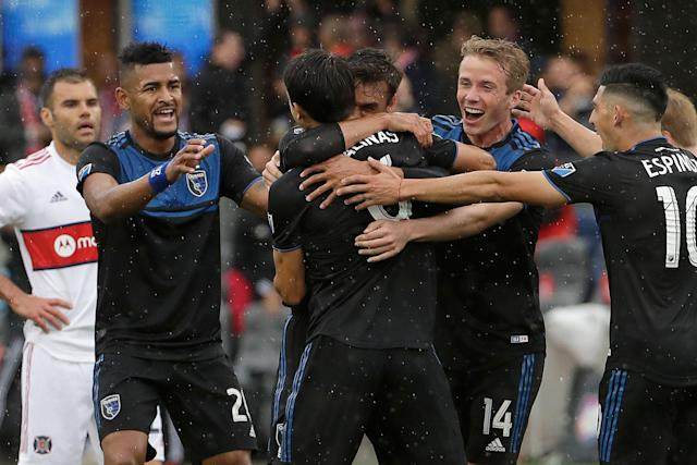 San Jose Earthquakes players mob forward Chris Wondolowski, who became the top goal scorer in MLS history in Saturday's 4-1 win over the Chicago Fire. (Jeff Chiu/AP)