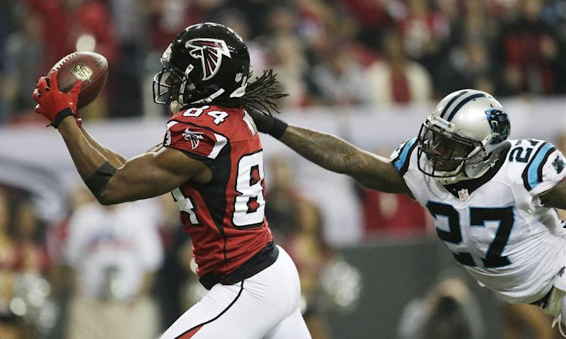 Atlanta Falcons wide receiver Roddy White (84) makes a touch-down catch against Carolina Panthers strong safety Quintin Mikell (27) during the second half of an NFL football game, Sunday, Dec. 29, 2013, in Atlanta