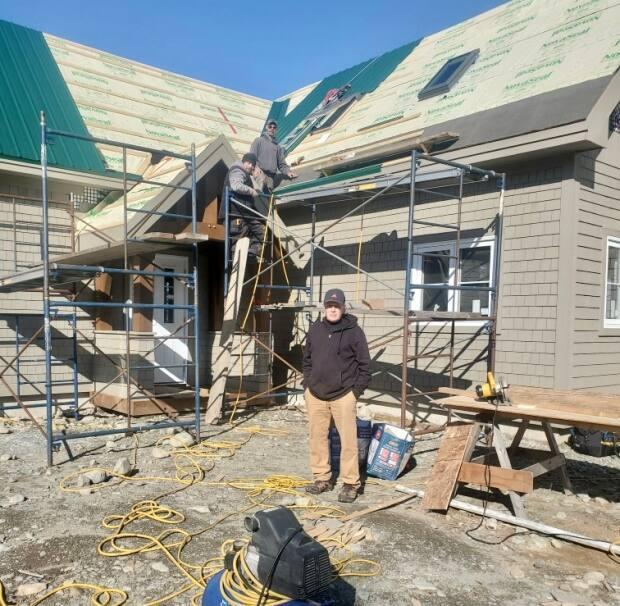 Iain Cocks stands in front of a home his crew is currently building in Port Joli, Queens County. Most lumber is now double or triple the price it was before the COVID-19 pandemic. (Eric Jardine - image credit)