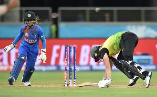 Australia's Ellyse Perry is bowled first ball by India's Poonam Yadav during the opening match of the women's Twenty20 World Cup tournament at the Sydney Showground