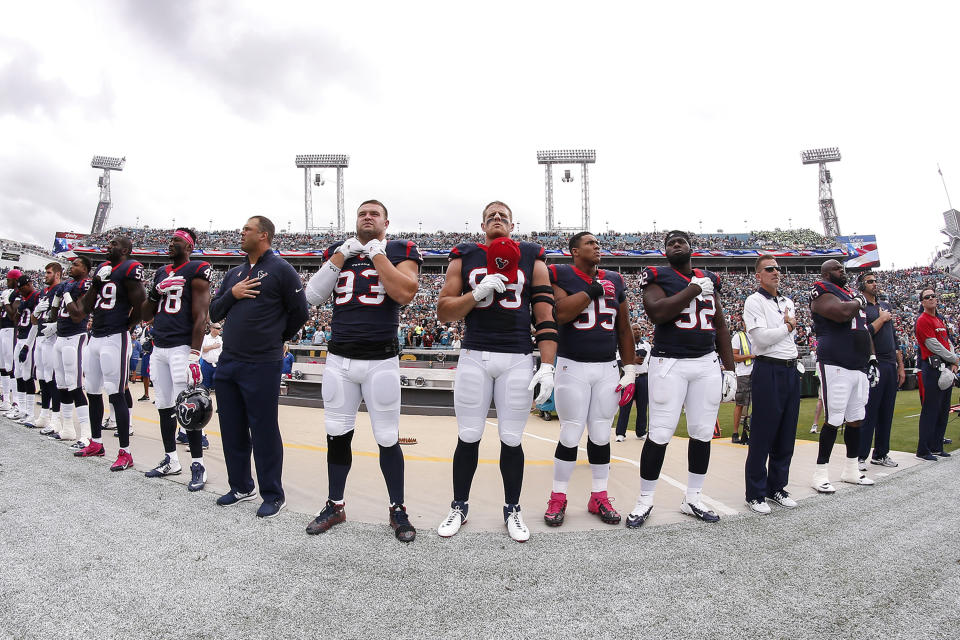 JACKSONVILLE, FL - OCTOBER 18: A general view of Defensive End J.J. Watt #99 and his teammates of the Houston Texans during the national anthem before playing the Jacksonville Jaguars at EverBank Field on October 18, 2015 in Jacksonville, Florida. The Texans defeated the Jaguars 31 to 20. (Photo by Don Juan Moore/Getty Images)