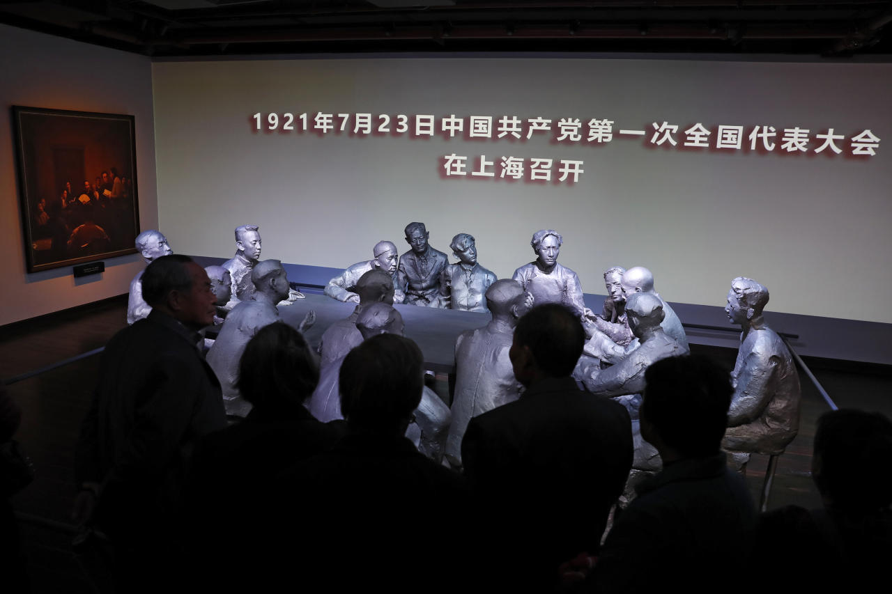 Chinese visitors are silhouetted as they look at the scene of the first National Congress of the Communist Party on display at the museum of the first National Congress of the Communist Party of China in Shanghai, China, Sunday, Nov. 19, 2017. Chinese tourists and visitors have flocked to the museum in Shanghai since President Xi Jinping made a visit with the newly-installed line-up of top party leaders late last month. During the leaders' visit, they were depicted on state television reaffirming their party oaths with their fists raised. (AP Photo/Andy Wong)