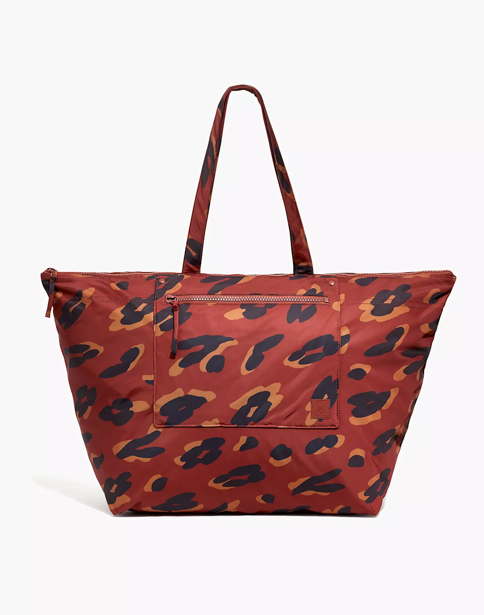 """<h2>The (Re)sourced Weekender Bag</h2><br>This weekender bag from Madewell is made from recycled materials, has many pockets, a padded laptop compartment, and a trolley sleeve that slips onto the handle of your rolling luggage bag.<br><br><em>Shop <strong><a href=""""https://www.madewell.com/"""" rel=""""nofollow noopener"""" target=""""_blank"""" data-ylk=""""slk:Madewell"""" class=""""link rapid-noclick-resp"""">Madewell</a></strong></em><br><br><strong>Madewell</strong> The (Re)sourced Weekender Bag, $, available at <a href=""""https://go.skimresources.com/?id=30283X879131&url=https%3A%2F%2Fwww.madewell.com%2Fthe-%2528re%2529sourced-weekender-bag-in-painted-leopard-MA362.html"""" rel=""""nofollow noopener"""" target=""""_blank"""" data-ylk=""""slk:Madewell"""" class=""""link rapid-noclick-resp"""">Madewell</a>"""