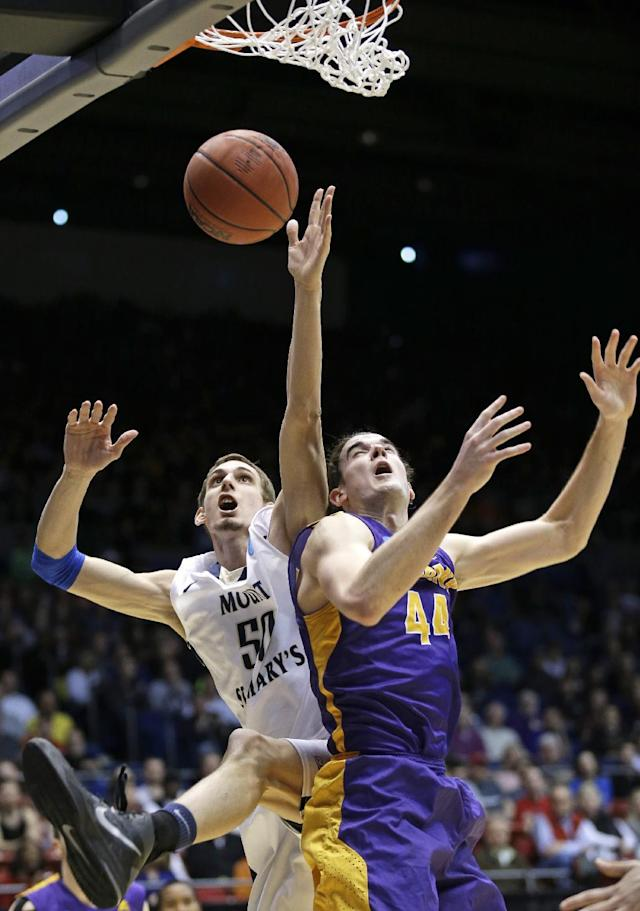 Mount St. Mary's center Taylor Danaher (50) goes up for a rebound against Albany center John Puk (44) in the second half of a first-round game of the NCAA college basketball tournament, Tuesday, March 18, 2014, in Dayton, Ohio. (AP Photo/Al Behrman)