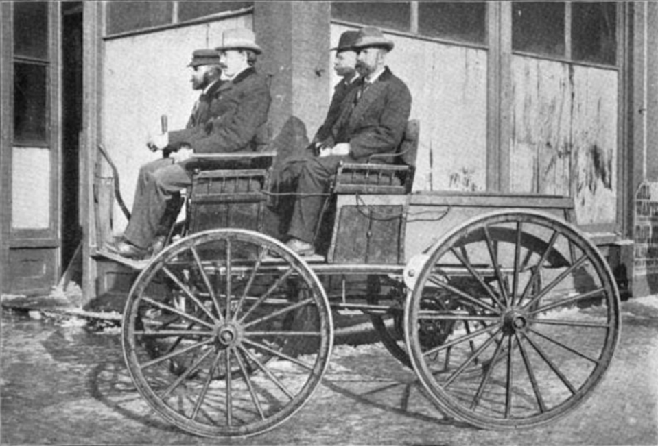A Sturgis Morrison electric carriage in 1895, modified with extra batteries under the front row and the back to give additional power for he Times-Herald automobile race. Source: Unknown author, Wikipedia.