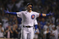 Chicago Cubs' Willson Contreras celebrates at the dugout after hitting a solo home run in the eighth inning of a baseball game against the Cincinnati Reds, Monday, July 26, 2021, in Chicago. (AP Photo/Paul Beaty)