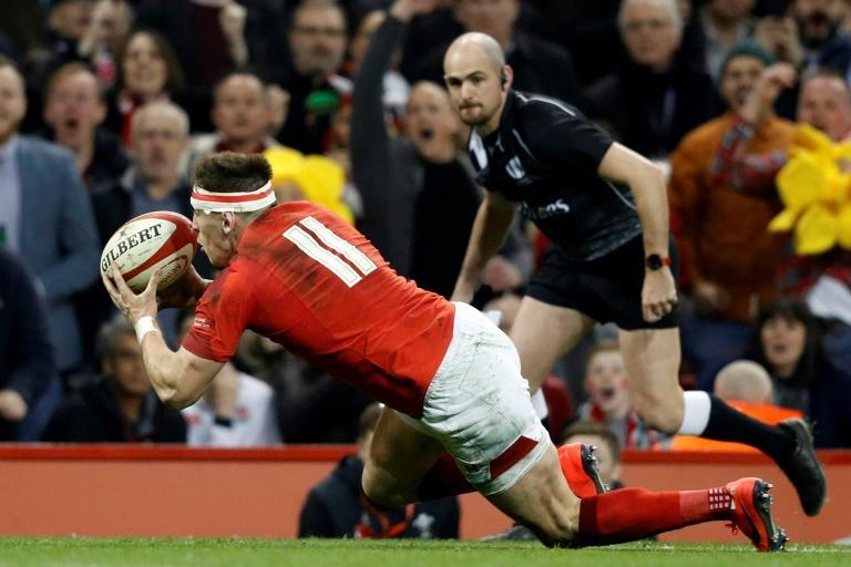 Wales' wing Josh Adams scored the clinching try two minutes from time to spark delirious scenes at the Principality Stadium