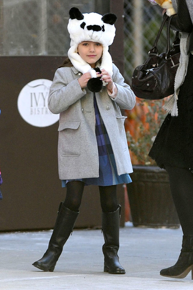 Suri Cruise wears a panda winter hat while coming with mom, Katie Holmes, out of Locanda Verde restaurant at the Greenwhich Hotel after attending a kid's party with playmates.