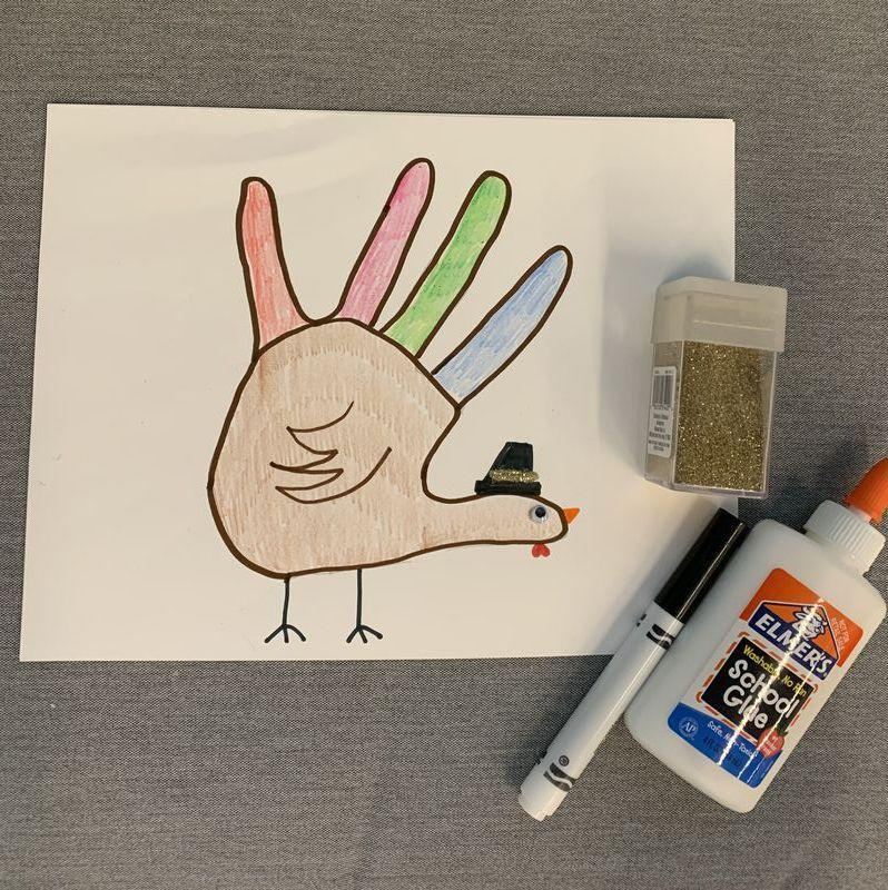 <p>Draw it in black marker, the run a line of glue for the buckle, sprinkle with glitter and shake. Your masterpiece is served!</p>