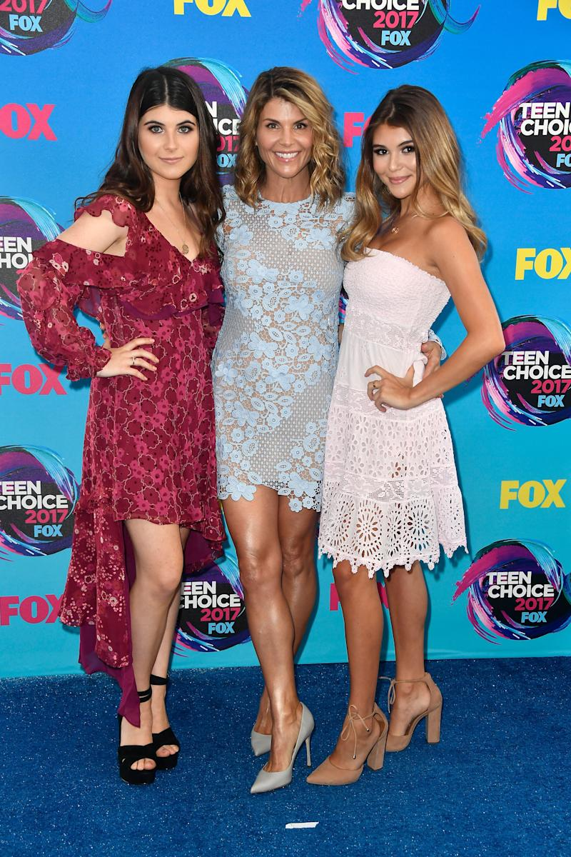 Actress Lori Loughlin, seen here in 2017 with her daughters, Isabella Rose Giannulli, left, and Olivia Jade Giannulli, is due back in federal court on April 3.