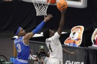 Memphis guard Landers Nolley II (3) defends as Colorado State guard Isaiah Stevens (4) leaps to the basket for a shot attempt in the second half of an NCAA college basketball game in the semifinals of the NIT, Saturday, March 27, 2021, in Frisco, Texas. (AP Photo/Tony Gutierrez)