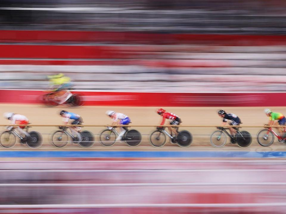 A blurred view of track cycling at the Tokyo Olympics