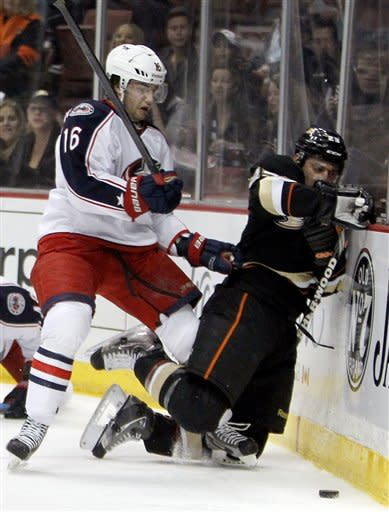 Columbus Blue Jackets center Derick Brassard (16) hits Anaheim Ducks defenseman Francois Beauchemin (23) into the boards during the first period of an NHL hockey game in Anaheim, Calif., Sunday, Jan. 8, 2012. (AP Photo/Alex Gallardo)