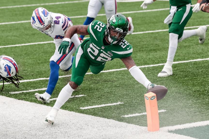 Oct 25, 2020; East Rutherford, New Jersey, USA; New York Jets running back La'Mical Perine (22) scores a rushing touchdown in front of Buffalo Bills cornerback Taron Johnson (24) during the first half at MetLife Stadium. Mandatory Credit: Vincent Carchietta-USA TODAY Sports