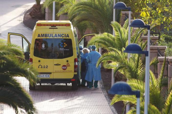 """A tourist affected by """"coronavirus"""" is transferred to a hospital from the hotel H10 Costa Adeje Palace, which is on lockdown after novel coronavirus has been confirmed in Adeje"""