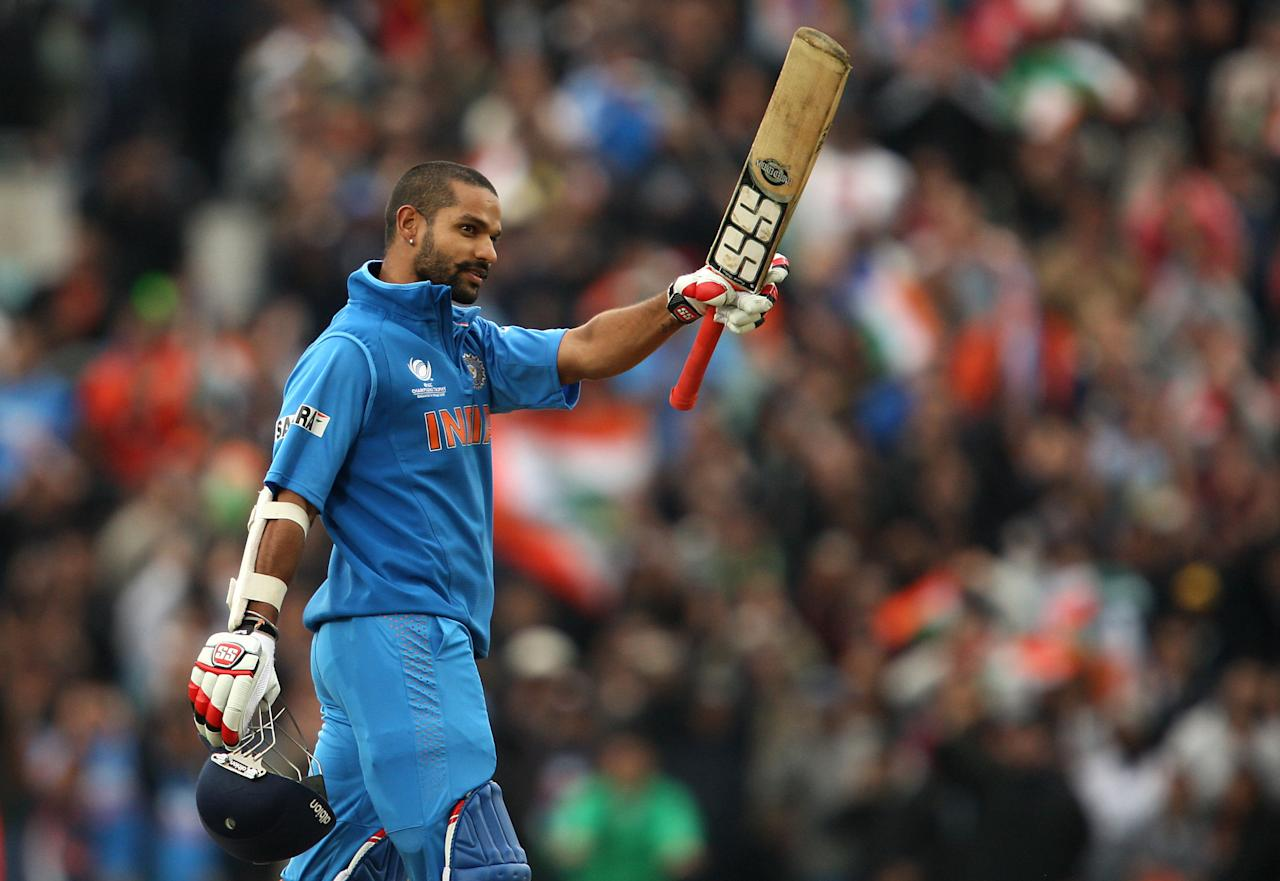 India's Shikhar Dhawan celebrates reaching his century during the ICC Champions Trophy match at the Kia Oval, London.