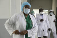 Dr. Oumaima Djarma, left, walks with other doctors dealing with COVID-19 patients, inside the Farcha provincial hospital in N'Djamena, Chad, Friday April 30, 2021. While the world's wealthier nations have stockpiled coronavirus vaccines for their citizens, many poorer countries are scrambling to secure enough doses, and some, like Chad, have yet to receive any. (AP Photo/Sunday Alamba)