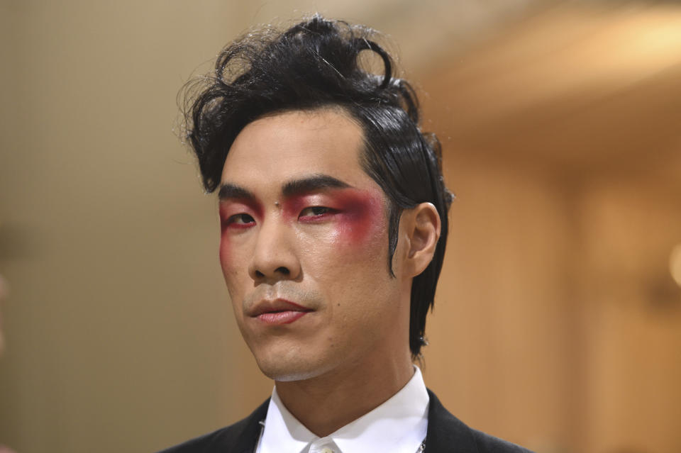 """Eugene Lee Yang attends The Metropolitan Museum of Art's Costume Institute benefit gala celebrating the opening of the """"In America: A Lexicon of Fashion"""" exhibition on Monday, Sept. 13, 2021, in New York. (Photo by Evan Agostini/Invision/AP)"""