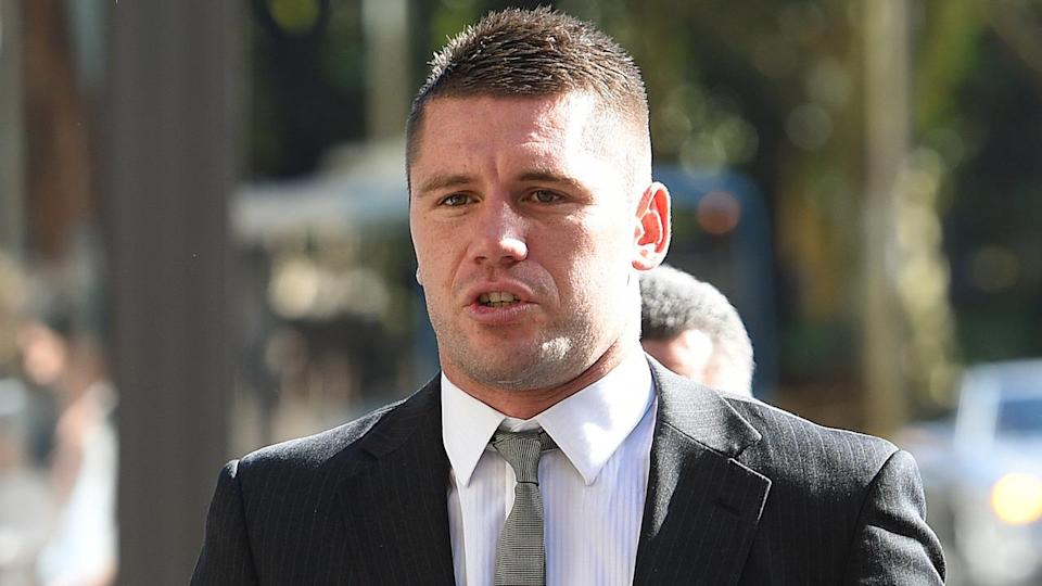 NRL player Shaun Kenny-Dowall has denied his former partner's claims of domestic violence in court.