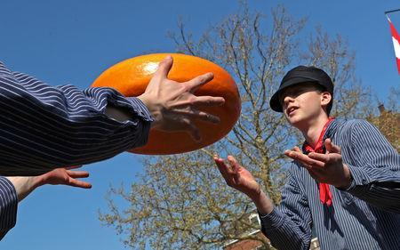 Sellers throw Gouda wheels at the cheese market in Gouda, Netherlands April 18, 2019. REUTERS/Yves Herman
