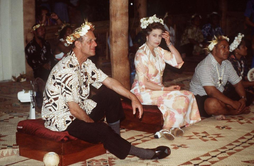 <p>The Queen and Prince Philip attending A Traditional Feast during their tour of the South Pacific in October 1962.</p>