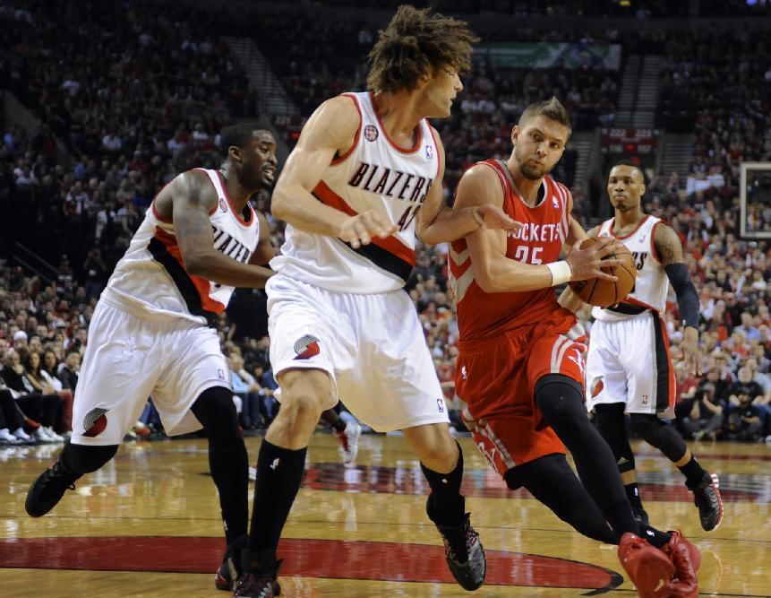 Houston Rockets' Chandler Parsons (25) drives to the basket against Portland Trail Blazers' Robin Lopez (42) during the first half of game six of an NBA basketball first-round playoff series game in Portland, Ore., Friday May 2, 2014. (AP Photo/Greg Wahl-Stephens)