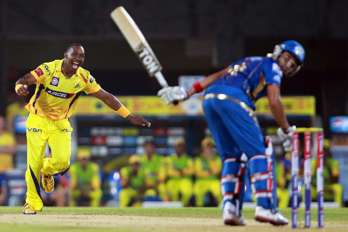 Dwayne Bravo celebrates the wicket of Rohit Sharma during match 5 of of the Pepsi Indian Premier League between The Chennai Superkings and the Mumbai Indians held at the MA Chidambaram Stadiumin Chennai on the 6th April 2013. Photo by Jacques Rossouw-IPL-SPORTZPICS..Use of this image is subject to the terms and conditions as outlined by the BCCI. These terms can be found by following this link:..https://ec.yimg.com/ec?url=http%3a%2f%2fwww.sportzpics.co.za%2fimage%2fI0000SoRagM2cIEc&t=1506313392&sig=u5D0Av6K6ya6N7QMhEanHQ--~D