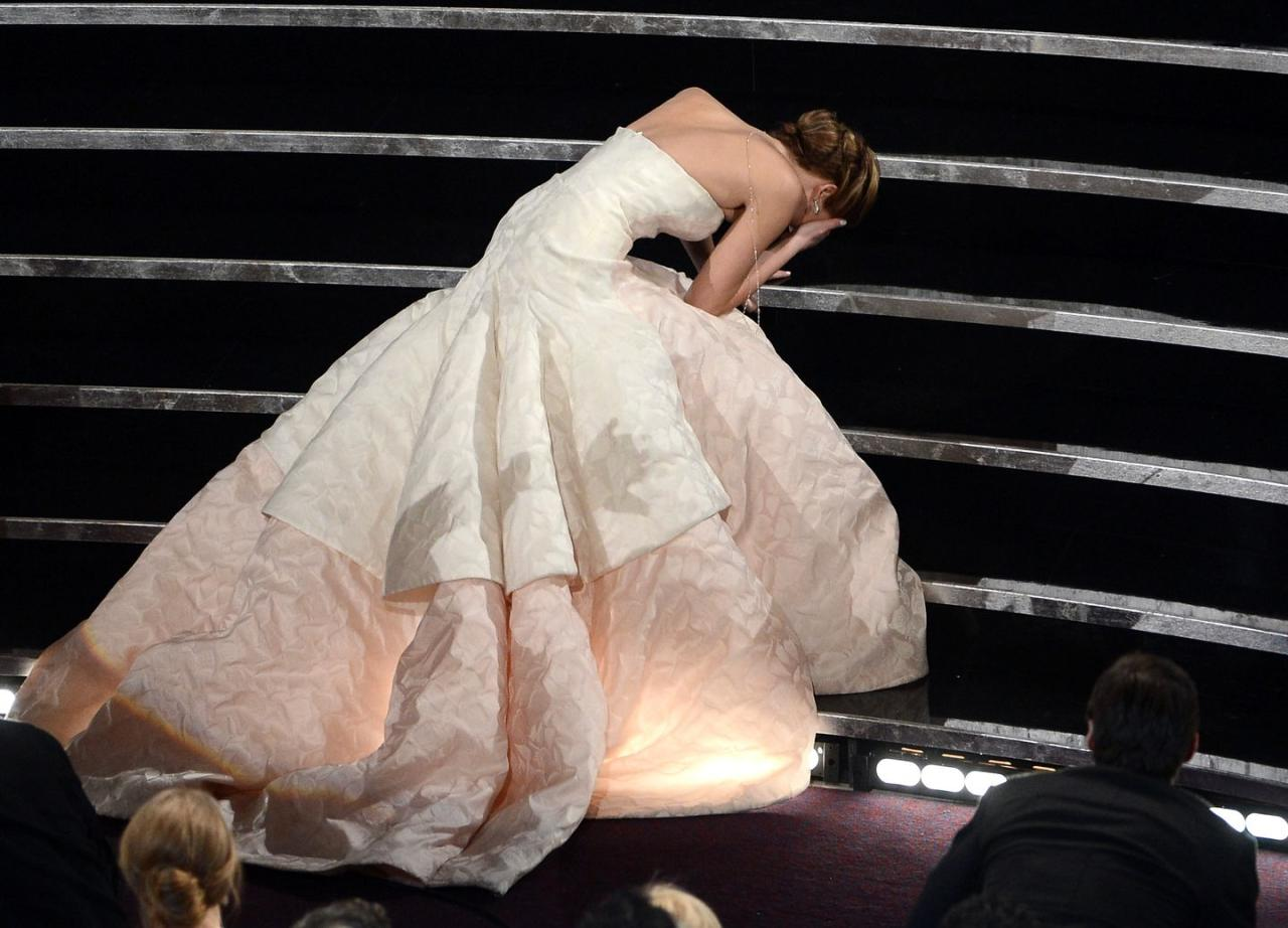 <p>The world took a collective gasp when Jennifer Lawrence tripped and fell as she went up on stage to collect her Leading Actress Oscar in 2013 - but while she might wish the moment had never happened, it did allow us the perfect shot of her stunning Dior couture gown splayed out across the steps. The elegant gown, by then-creative director Raf Simons, featured a strapless neckline and textured double-layered skirt. <br></p>
