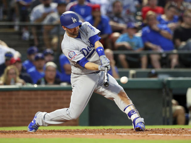 Los Angeles Dodgers Brian Dozier (6) hits a single in the third inning against the Texas Rangers in a baseball game Tuesday, Aug. 28, 2018, in Arlington, Texas. (AP Photo/Richard W. Rodriguez)
