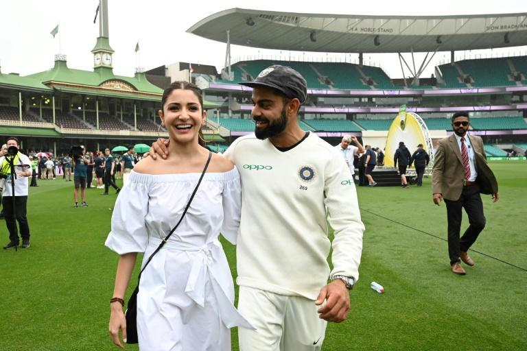 Virat Kohli (right) will leave the tour after the first of four Tests, for the birth of his first child with Bollywood actress Anushka Sharma (left)