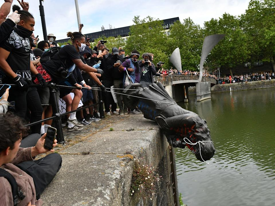 <p>The statue of slave trader Edward Colston was removed by protesters and thrown in water last year</p> (PA)