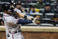 Atlanta Braves' Dansby Swanson follows through on a three-run home run during the third inning of a baseball game against the New York Mets Tuesday, June 22, 2021, in New York. (AP Photo/Frank Franklin II)