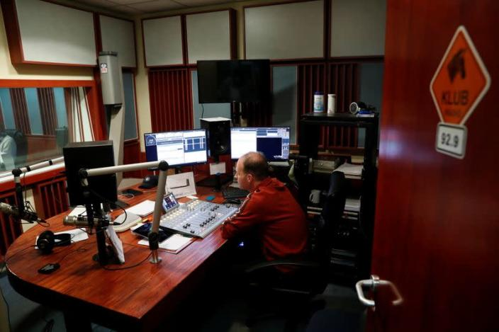 FILE PHOTO: An employee of the opposition radio-station Klubradio works at its headquarters in Budapest